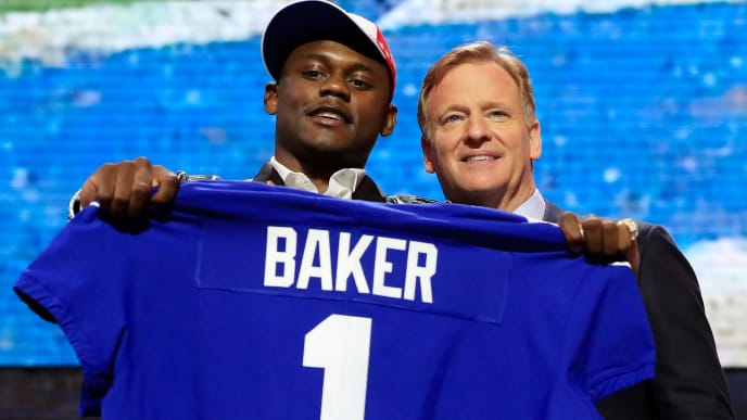 NASHVILLE, TENNESSEE - APRIL 25:  Deandre Baker of Georgia poses with NFL Commissioner Roger Goodell after being chosen #30 overall by the New York Giants during the first round of the 2019 NFL Draft on April 25, 2019 in Nashville, Tennessee. (Photo by Andy Lyons/Getty Images)