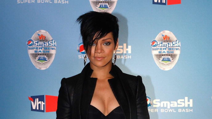 TAMPA, FL - JANUARY 29:  Singer Rihanna poses in the press room after her performance at the NFL Pepsi Smash Super Bowl Concert held at the Ford Amphitheatre at the Florida State Fairgrounds on January 29, 2009 in Tampa, Florida.  (Photo by Kevin C. Cox/Getty Images for NFL)