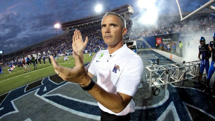 MEMPHIS, TN - SEPTEMBER 26: Mike Norvell, head coach of the Memphis Tigers prepares to lead his team on the field before a game against the Navy Midshipmen on September 26, 2019 at Liberty Bowl Memorial Stadium in Memphis, Tennessee. Memphis defeated Navy 35-23. (Photo by Joe Murphy/Getty Images)
