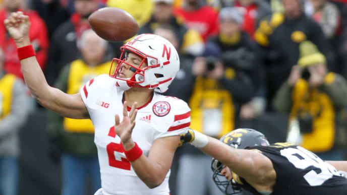 IOWA CITY, IOWA- NOVEMBER 23:  Defensive end Anthony Nelson #98 of the Iowa Hawkeyes gets a hand on the ball during the second half against quarterback Adrian Martinez #2 of the Nebraska Cornhuskers on November 23, 2018 at Kinnick Stadium, in Iowa City, Iowa.  (Photo by Matthew Holst/Getty Images)
