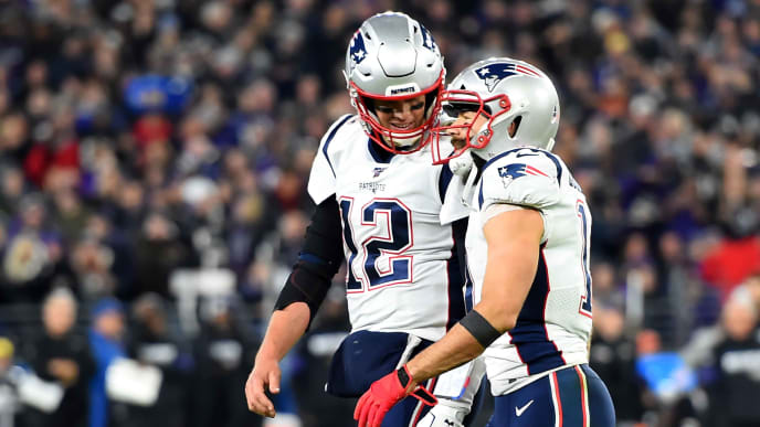 BALTIMORE, MD - NOVEMBER 03: Tom Brady #12 and Julian Edelman #11 of the New England Patriots speak during the game against the Baltimore Ravens at M&T Bank Stadium on November 3, 2019 in Baltimore, Maryland. (Photo by Will Newton/Getty Images)