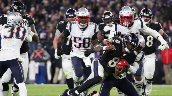 BALTIMORE, MARYLAND - NOVEMBER 03: Quarterback Lamar Jackson #8 of the Baltimore Ravens rushes against the New England Patriots during the fourth quarter at M&T Bank Stadium on November 3, 2019 in Baltimore, Maryland. (Photo by Todd Olszewski/Getty Images)