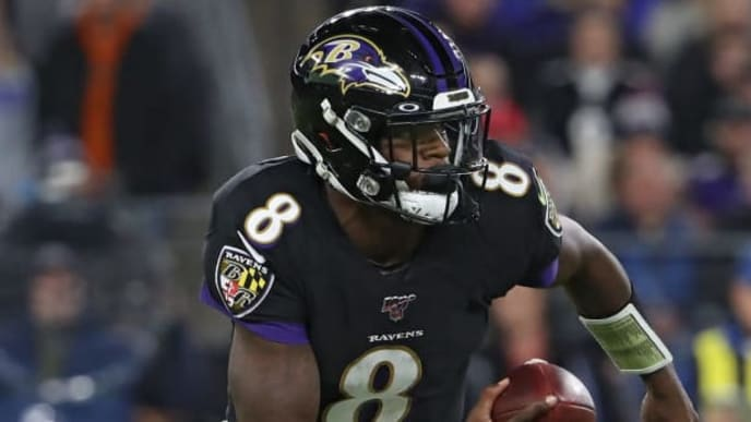 BALTIMORE, MARYLAND - NOVEMBER 03: Quarterback Lamar Jackson #8 of the Baltimore Ravens rushes against the New England Patriots during the second quarter at M&T Bank Stadium on November 3, 2019 in Baltimore, Maryland. (Photo by Todd Olszewski/Getty Images)