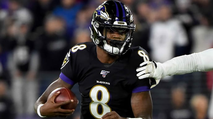 BALTIMORE, MD - NOVEMBER 03: Lamar Jackson #8 of the Baltimore Ravens runs against the New England Patriots during the game at M&T Bank Stadium on November 3, 2019 in Baltimore, Maryland. (Photo by Will Newton/Getty Images)
