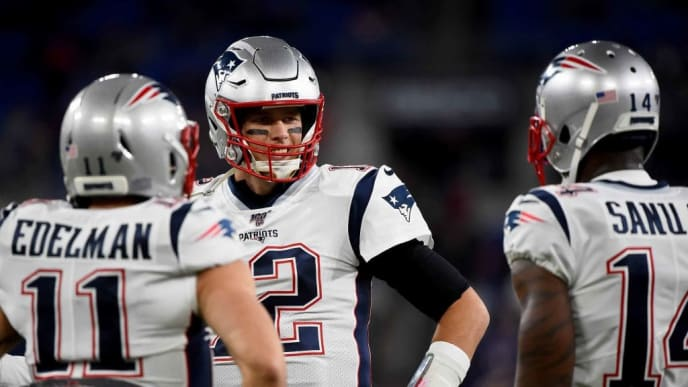 BALTIMORE, MD - NOVEMBER 03: Tom Brady #12 speaks with Julian Edelman #11 and Mohamed Sanu #14 of the New England Patriots prior to the game against the Baltimore Ravens at M&T Bank Stadium on November 3, 2019 in Baltimore, Maryland. (Photo by Will Newton/Getty Images)