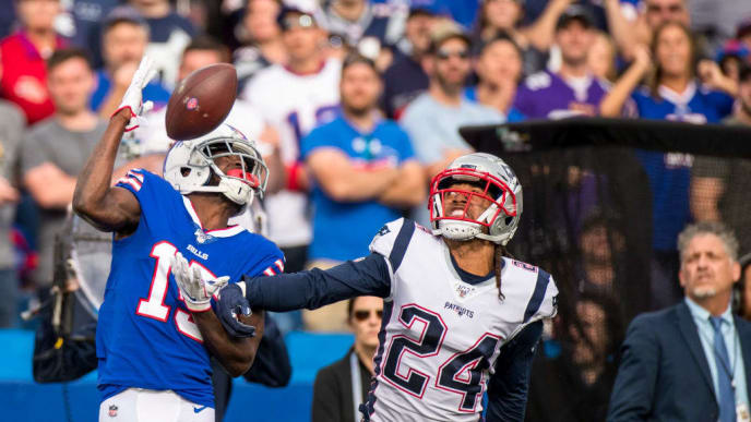ORCHARD PARK, NY - SEPTEMBER 29:  John Brown #15 of the Buffalo Bills makes a first down reception while being defended by Stephon Gilmore #24 of the New England Patriots during the fourth quarter at New Era Field on September 29, 2019 in Orchard Park, New York. New England defeats Buffalo 16-10.  (Photo by Brett Carlsen/Getty Images)