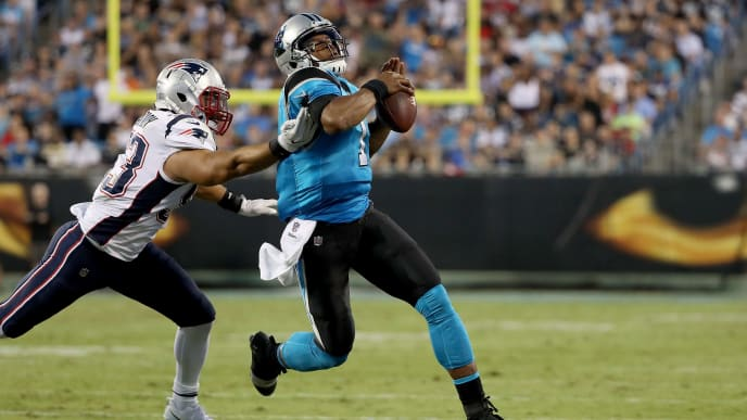 CHARLOTTE, NC - AUGUST 24:  Cam Newton #1 of the Carolina Panthers runs from Kyle Van Noy #53 of the New England Patriots in the first quarter during their game at Bank of America Stadium on August 24, 2018 in Charlotte, North Carolina.  (Photo by Streeter Lecka/Getty Images)