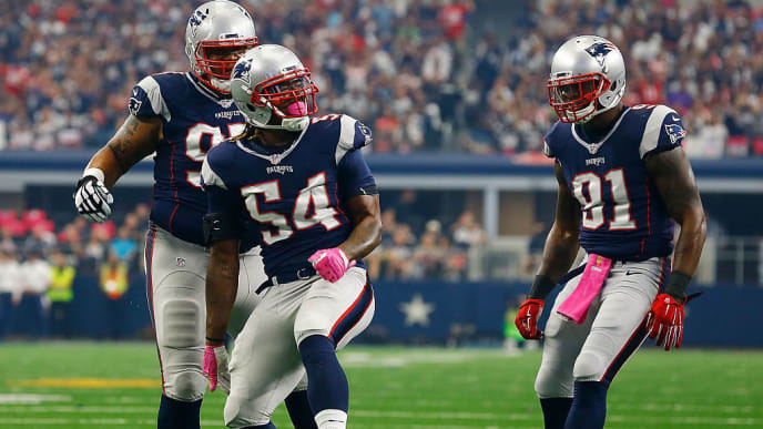 ARLINGTON, TX - OCTOBER 11:  New England Patriots Alan Branch #97 of the New England Patriots, Dont'a Hightower #54 of the New England Patriots and Jamie Collins #91 of the New England Patriots celebrate after sacking Brandon Weeden #3 of the Dallas Cowboys  during the first half of the NFL game at AT&T Stadium on October 11, 2015 in Arlington, Texas.  (Photo by Mike Stone/Getty Images)