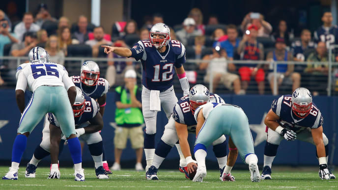ARLINGTON, TX - OCTOBER 11:  Tom Brady #12 of the New England Patriots directs the offense during the NFL game against the Dallas Cowboys at AT&T Stadium on October 11, 2015 in Arlington, Texas.  (Photo by Mike Stone/Getty Images)