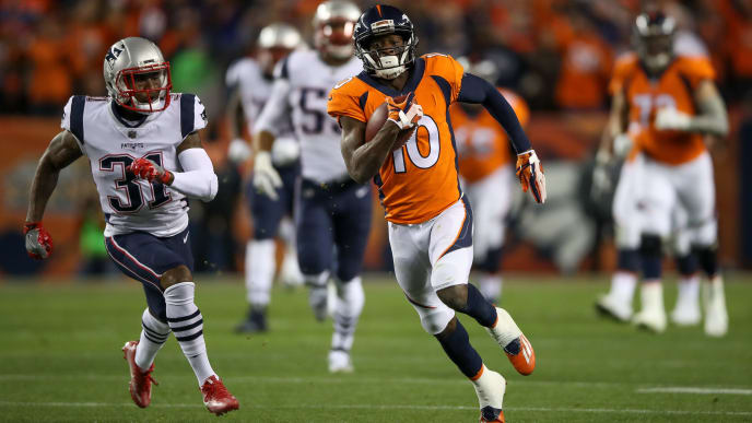 DENVER, CO - NOVEMBER 13:  Wide receiver Emmanuel Sanders #10 of the Denver Broncos has yardage after a catch in the first half of a game against the New England Patriots at Sports Authority Field at Mile High on November 12, 2017 in Denver, Colorado. (Photo by Matthew Stockman/Getty Images)