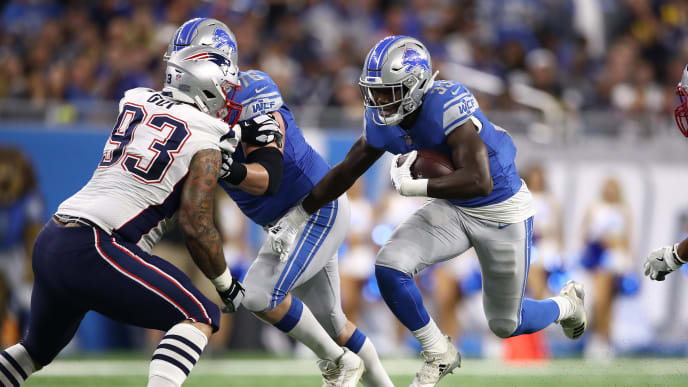 DETROIT, MI - SEPTEMBER 23: Kerryon Johnson #33 of the Detroit Lions runs with the ball while playing the New England Patriots at Ford Field on September 23, 2018 in Detroit, Michigan. (Photo by Gregory Shamus/Getty Images)