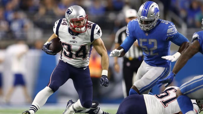 DETROIT, MI - SEPTEMBER 23: Rex Burkhead #34 of the New England Patriots during a run against the Detroit Lions at Ford Field on September 23, 2018 in Detroit, Michigan. (Photo by Gregory Shamus/Getty Images)