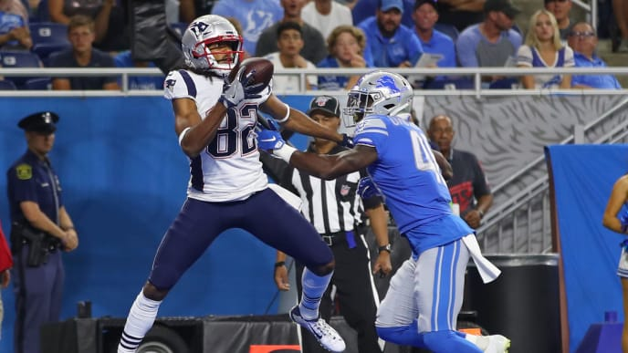 DETROIT, MICHIGAN - AUGUST 08: Maurice Harris #82 of the New England Patriots catches a first quarter touchdown next to Amani Oruwariye #46 of the Detroit Lions during a preseason game at Ford Field on August 08, 2019 in Detroit, Michigan. (Photo by Gregory Shamus/Getty Images)