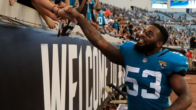 JACKSONVILLE, FL - SEPTEMBER 16:  Blair Brown #53 of the Jacksonville Jaguars celebrates with fans following the game against the New England Patriots at TIAA Bank Field on September 16, 2018 in Jacksonville, Florida.  (Photo by Sam Greenwood/Getty Images)
