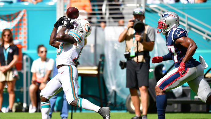 MIAMI, FLORIDA - SEPTEMBER 15: Jakeem Grant #19 of the Miami Dolphins drops a pass in the fourth quarter against the New England Patriots at Hard Rock Stadium on September 15, 2019 in Miami, Florida. (Photo by Mark Brown/Getty Images)