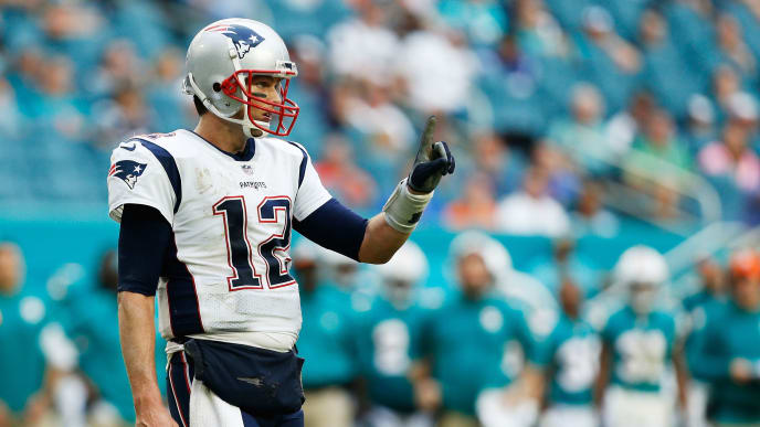 MIAMI, FL - DECEMBER 09: Tom Brady #12 of the New England Patriots reacts during the second half against the Miami Dolphins at Hard Rock Stadium on December 9, 2018 in Miami, Florida.  (Photo by Michael Reaves/Getty Images)