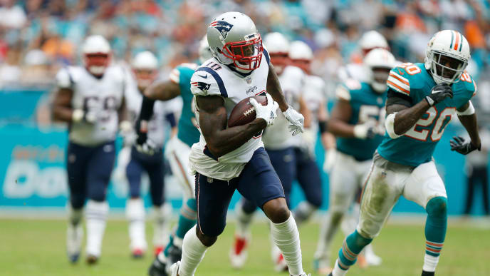 MIAMI, FL - DECEMBER 09: Josh Gordon #10 of the New England Patriots carries the ball durig the second half against the Miami Dolphins at Hard Rock Stadium on December 9, 2018 in Miami, Florida.  (Photo by Michael Reaves/Getty Images)