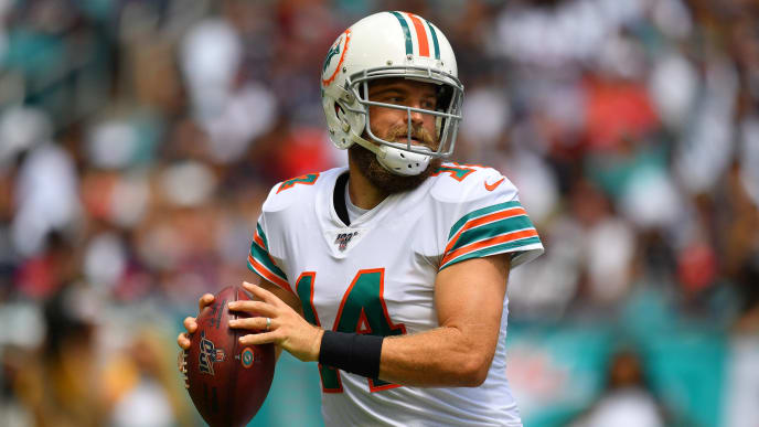 MIAMI, FLORIDA - SEPTEMBER 15: Ryan Fitzpatrick #14 of the Miami Dolphinslooks to pass in the first quarter against the New England Patriots at Hard Rock Stadium on September 15, 2019 in Miami, Florida. (Photo by Mark Brown/Getty Images)