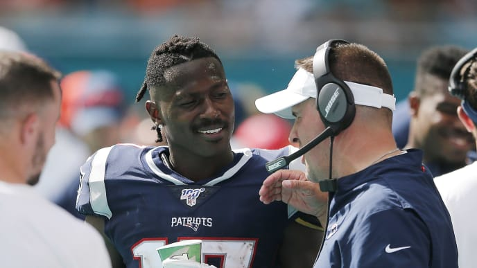 MIAMI, FLORIDA - SEPTEMBER 15:  Antonio Brown #17 of the New England Patriots talks with offensive coordinator Josh McDaniels against the Miami Dolphins at Hard Rock Stadium on September 15, 2019 in Miami, Florida. (Photo by Michael Reaves/Getty Images)