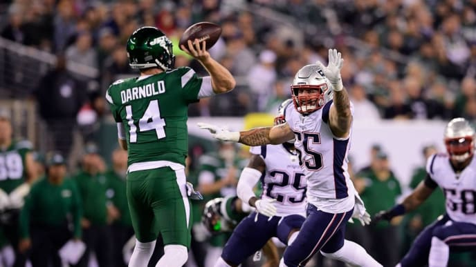 EAST RUTHERFORD, NEW JERSEY - OCTOBER 21:  John Simon #55 of the New England Patriots attempts to block the pass from Sam Darnold #14 of the New York Jets during the first half at MetLife Stadium on October 21, 2019 in East Rutherford, New Jersey. (Photo by Steven Ryan/Getty Images)
