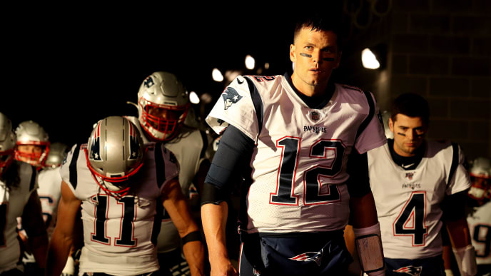 EAST RUTHERFORD, NEW JERSEY - OCTOBER 21:   Quarterback Tom Brady #12 of the New England Patriots leads his team onto the field before the game against the New York Jets at MetLife Stadium on October 21, 2019 in East Rutherford, New Jersey. (Photo by Al Bello/Getty Images)