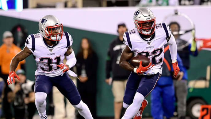 EAST RUTHERFORD, NEW JERSEY - OCTOBER 21:  Devin McCourty #32 of the New England Patriots intercepts the ball against the New York Jets during the first half at MetLife Stadium on October 21, 2019 in East Rutherford, New Jersey. (Photo by Steven Ryan/Getty Images)