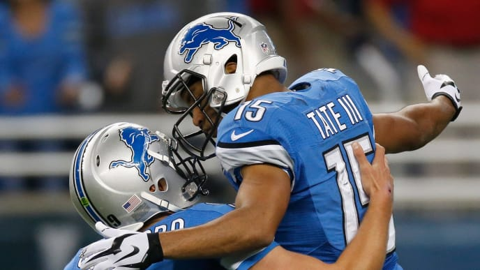 DETROIT, MI - OCTOBER 19: Golden Tate #15 celebrates with Matthew Stafford #9 of the Detroit Lions after a 73-yard touchdown against the New Orleans Saints at Ford Field on October 19, 2014 in Detroit, Michigan. (Photo by Greg Shamus/Getty Images)