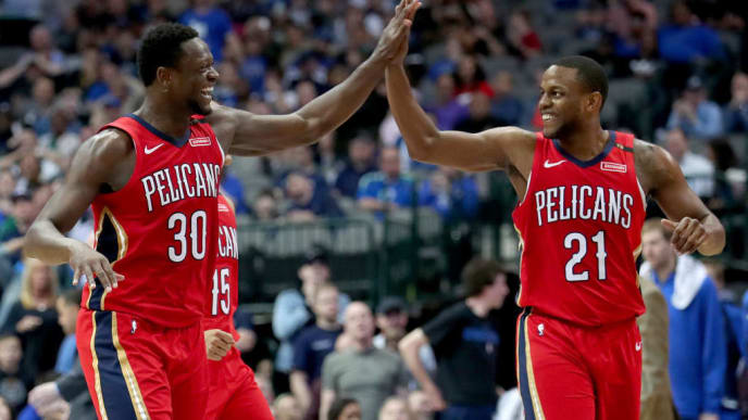 DALLAS, TEXAS - MARCH 18: Julius Randle #30 of the New Orleans Pelicans celebrates with Darius Miller #21 of the New Orleans Pelicans in the fourth quarter against the Dallas Mavericks at American Airlines Center on March 18, 2019 in Dallas, Texas. NOTE TO USER: User expressly acknowledges and agrees that, by downloading and or using this photograph, User is consenting to the terms and conditions of the Getty Images License Agreement. (Photo by Tom Pennington/Getty Images)