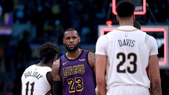LOS ANGELES, CALIFORNIA - DECEMBER 21:  LeBron James #23 of the Los Angeles Lakers reacts in front of Anthony Davis #23 of the New Orleans Pelicans after a 112-104 Laker win at Staples Center on December 21, 2018 in Los Angeles, California.  NOTE TO USER: User expressly acknowledges and agrees that, by downloading and or using this photograph, User is consenting to the terms and conditions of the Getty Images License Agreement. (Photo by Harry How/Getty Images)