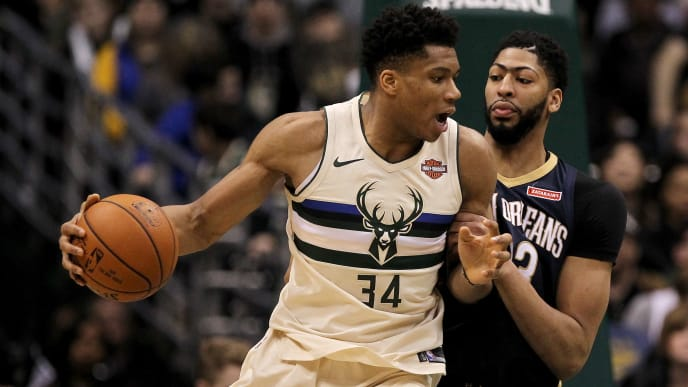 MILWAUKEE, WI - FEBRUARY 25:  Giannis Antetokounmpo #34 of the Milwaukee Bucks dribbles the ball while being guarded by Anthony Davis #23 of the New Orleans Pelicans in the fourth quarter at the Bradley Center on February 25, 2018 in Milwaukee, Wisconsin. NOTE TO USER: User expressly acknowledges and agrees that, by downloading and or using this photograph, User is consenting to the terms and conditions of the Getty Images License Agreement. (Photo by Dylan Buell/Getty Images)