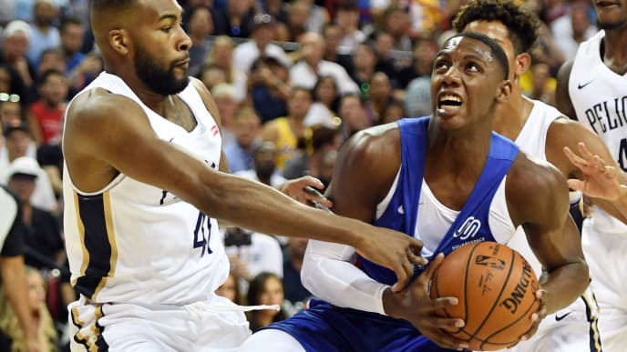 LAS VEGAS, NEVADA - JULY 05:  RJ Barrett #9 of the New York Knicks is fouled as he drives against Javon Bess #41 of the New Orleans Pelicans during the 2019 NBA Summer League at the Thomas & Mack Center on July 5, 2019 in Las Vegas, Nevada. NOTE TO USER: User expressly acknowledges and agrees that, by downloading and or using this photograph, User is consenting to the terms and conditions of the Getty Images License Agreement.  (Photo by Ethan Miller/Getty Images)