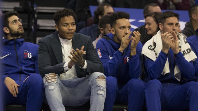 PHILADELPHIA, PA - NOVEMBER 21: (L-R) Furkan Korkmaz #30, Markelle Fultz #20, Landry Shamet #1, and T.J. McConnell #12 of the Philadelphia 76ers watch the game from the bench in the first quarter against the New Orleans Pelicans at the Wells Fargo Center on November 21, 2018 in Philadelphia, Pennsylvania. NOTE TO USER: User expressly acknowledges and agrees that, by downloading and or using this photograph, User is consenting to the terms and conditions of the Getty Images License Agreement. (Photo by Mitchell Leff/Getty Images)