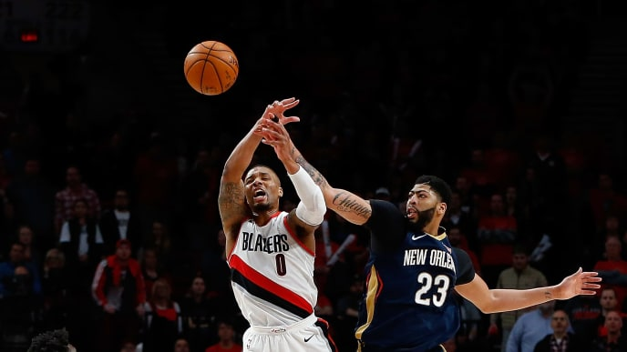 PORTLAND, OR - APRIL 17:  Anthony Davis #23 of the New Orleans Pelicans battles Damian Lillard #0 of the Portland Trail Blazers during Game One of the Western Conference Quarterfinals during the 2018 NBA Playoffs at Moda Center on April 17, 2018 in Portland, Oregon.  NOTE TO USER: User expressly acknowledges and agrees that, by downloading and or using this photograph, User is consenting to the terms and conditions of the Getty Images License Agreement.  (Photo by Jonathan Ferrey/Getty Images)