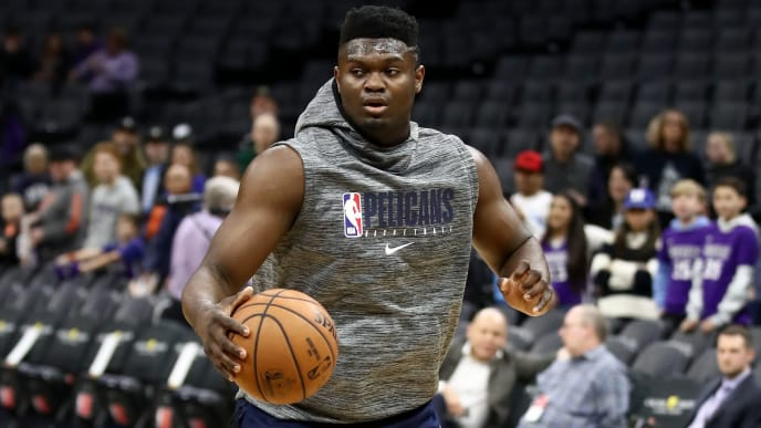 Zion Williamson warms up before a game against the Sacramento Kings.