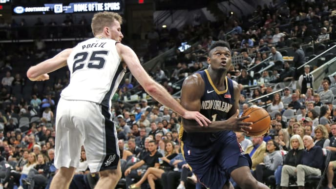 SAN ANTONIO,TX - OCTOBER 13:  Zion Williamson #1  of the New Orleans Pelicans drives on Jakob Poeltl #25 of the San Antonio Spurs in a pre-season game  at AT&T Center on October 13 , 2019 in San Antonio, Texas.  NOTE TO USER: User expressly acknowledges and agrees that , by downloading and or using this photograph, User is consenting to the terms and conditions of the Getty Images License Agreement. (Photo by Ronald Cortes/Getty Images)