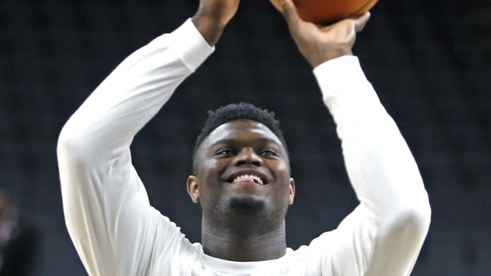 SAN ANTONIO,TX - OCTOBER 13:  Zion Williamson #1  of the New Orleans Pelicans takes a shot during pre-game warm-ups before pre-season game against the San Antonio Spurs  at AT&T Center on October 13 , 2019 in San Antonio, Texas.  NOTE TO USER: User expressly acknowledges and agrees that , by downloading and or using this photograph, User is consenting to the terms and conditions of the Getty Images License Agreement. (Photo by Ronald Cortes/Getty Images)