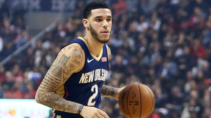 TORONTO, ON - OCTOBER 22:  Lonzo Ball #2 of the New Orleans Pelicans dribbles the ball during the first half of an NBA game against the Toronto Raptors at Scotiabank Arena on October 22, 2019 in Toronto, Canada.  NOTE TO USER: User expressly acknowledges and agrees that, by downloading and or using this photograph, User is consenting to the terms and conditions of the Getty Images License Agreement.  (Photo by Vaughn Ridley/Getty Images)