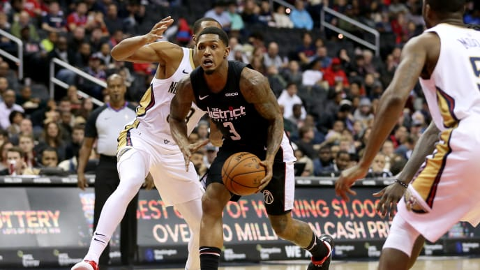 WASHINGTON, DC - NOVEMBER 24: Bradley Beal #3 of the Washington Wizards dribbles in front of Wesley Johnson #33 of the New Orleans Pelicans of the New Orleans Pelicans during the first half at Capital One Arena on November 24, 2018 in Washington, DC. NOTE TO USER: User expressly acknowledges and agrees that, by downloading and or using this photograph, User is consenting to the terms and conditions of the Getty Images License Agreement. (Photo by Will Newton/Getty Images)
