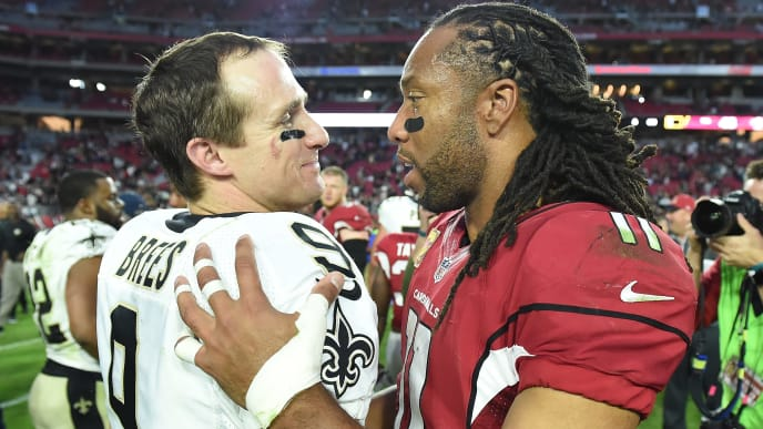 GLENDALE, AZ - DECEMBER 18:  Wide receiver Larry Fitzgerald #11 of the Arizona Cardinals and quarterback Drew Brees #9 of the New Orleans Saints hug after the NFL game at University of Phoenix Stadium on December 18, 2016 in Glendale, Arizona.  The New Orleans Saints won 48-41.  (Photo by Norm Hall/Getty Images)
