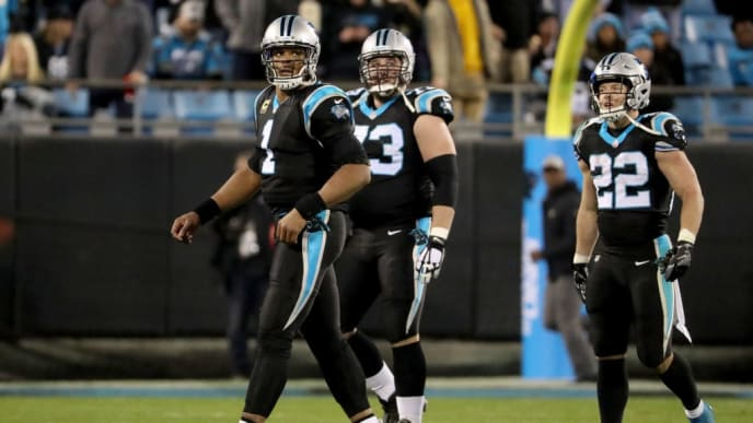 CHARLOTTE, NC - DECEMBER 17: Cam Newton #1 and teammates Christian McCaffrey #22 and Greg Van Roten #73 of the Carolina Panthers react after losing 12-9 to the New Orleans Saints at Bank of America Stadium on December 17, 2018 in Charlotte, North Carolina.  (Photo by Streeter Lecka/Getty Images)