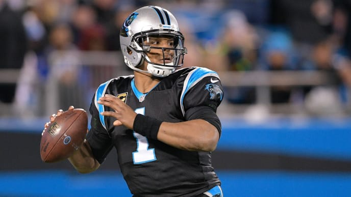 CHARLOTTE, NC - DECEMBER 17:  Cam Newton #1 of the Carolina Panthers throws a pass against the New Orleans Saints in the third quarter during their game at Bank of America Stadium on December 17, 2018 in Charlotte, North Carolina.  (Photo by Grant Halverson/Getty Images)