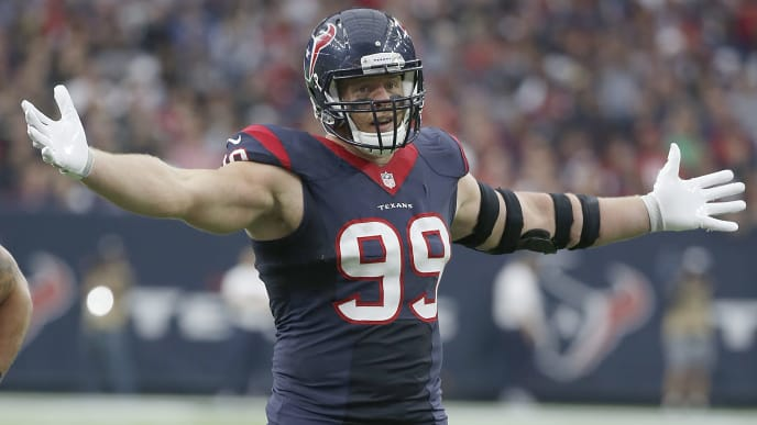HOUSTON, TX - NOVEMBER 29: J.J. Watt #99 of the Houston Texans reatcs after making a defensive play against the New Orleans Saints in the third quarter on November 29, 2015 at NRG Stadium in Houston, Texas. (Photo by Scott Halleran/Getty Images)