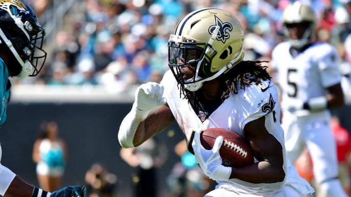 JACKSONVILLE, FLORIDA - OCTOBER 13: Running back Alvin Kamara #41 of the New Orleans Saints runs with the ball during the second quarter of the game against the Jacksonville Jaguars at TIAA Bank Field on October 13, 2019 in Jacksonville, Florida. (Photo by Julio Aguilar/Getty Images)
