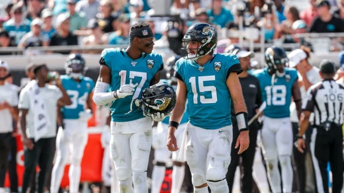 JACKSONVILLE, FL - OCTOBER 13:  Wide receiver DJ Chark, Jr. #17 and quarterback Gardner Minshew II #15 of the Jacksonville Jaguars return to the field after a time out against the New Orleans Saints at TIAA Bank Field on October 13, 2019 in Jacksonville, Florida. The Saints defeated the Jaguars 13-6. (Photo by Don Juan Moore/Getty Images)