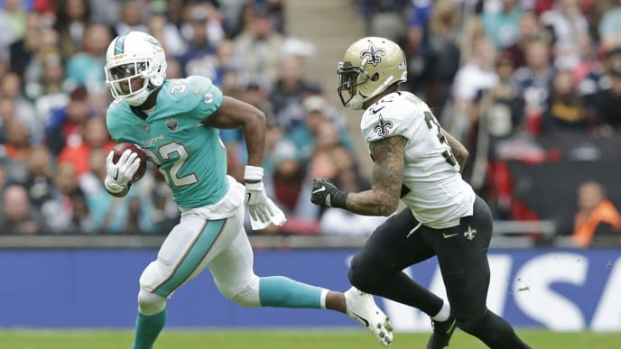 LONDON, ENGLAND - OCTOBER 01: Kenyan Drake of the Miami Dolphins and Kenny Vaccaro of the New Orleans Saints during the NFL game between the Miami Dolphins and the New Orleans Saints at Wembley Stadium on October 1, 2017 in London, England. (Photo by Henry Browne/Getty Images)