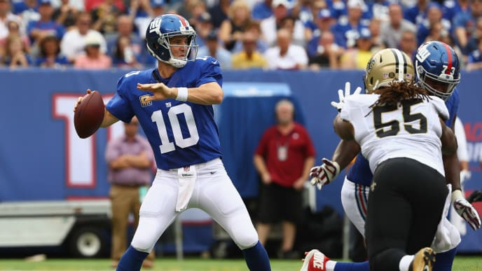 EAST RUTHERFORD, NJ - SEPTEMBER 18:  Quarterback  Eli Manning #10 of the New York Giants throws a pass against the New Orleans Saints during the first quarter at MetLife Stadium on September 18, 2016 in East Rutherford, New Jersey.  (Photo by Al Bello/Getty Images)