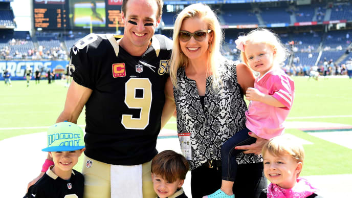 SAN DIEGO, CA - OCTOBER 02:  Drew Brees #9 of the New Orleans Saints poses for a photo with his family before the game against the San Diego Chargers during the fourth quarter at Qualcomm Stadium on October 2, 2016 in San Diego, California.  (Photo by Harry How/Getty Images)