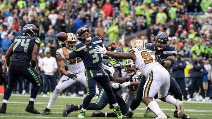 SEATTLE, WA - SEPTEMBER 22: Quarterback Russell Wilson #3 of the Seattle Seahawks is pressured by defensive linemen Mario Edwards Jr. #97 of the New Orleans Saints and Marcus Davenport #92 during the second half of a game at CenturyLInk Field on September 22, 2019 in Seattle, Washington. The Saints won 33-27. (Photo by Stephen Brashear/Getty Images)