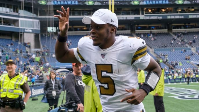 SEATTLE, WA - SEPTEMBER 22: Quarterback Teddy Bridgewater #5 of the New Orleans Saints waves to fans as he jogs off the field after a game against the Seattle Seahawks at CenturyLInk Field on September 22, 2019 in Seattle, Washington. The Saints won 33-27. (Photo by Stephen Brashear/Getty Images)