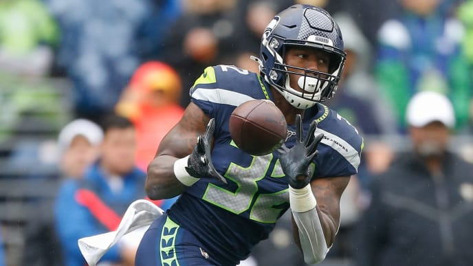 SEATTLE, WA - SEPTEMBER 22:  Running back Chris Carson #32 of the Seattle Seahawks makes a catch against the New Orleans Saints at CenturyLink Field on September 22, 2019 in Seattle, Washington.  (Photo by Otto Greule Jr/Getty Images)